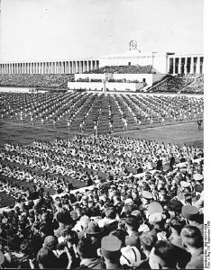 "Nuremberg Rally. Mass calisthenics on the Zeppelin Meadow on September 8, 1938, the ""Community Day."" Source: [https://commons.wikimedia.org/wiki/File:Bundesarchiv_Bild_183-H11954,_N%C3%BCrnberg,_Reichsparteitag,_Turnvorf%C3%BChrung.jpg Bundesarchiv Signatur: Bild 183-H11954] [https://creativecommons.org/licenses/by-sa/3.0/de/deed.en CC BY-SA 3.0 DE]"