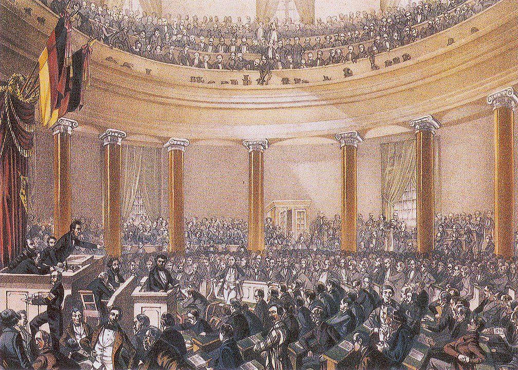 Sitzung der Nationalversammlung in der Paulskirche; der Redner ist Robert Blum, ca. Juni 1848. Urheber: Ludwig von Elliott. Quelle: [https://commons.wikimedia.org/wiki/File:Frankfurt_Nationalversammlung_1848.jpg Wikimedia Commons] gemeinfrei